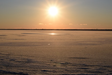 Looking out over a frozen bay as the sun began to set